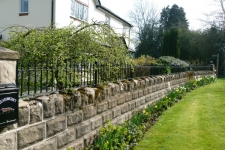 simple-railing-atop-a-stone-wall